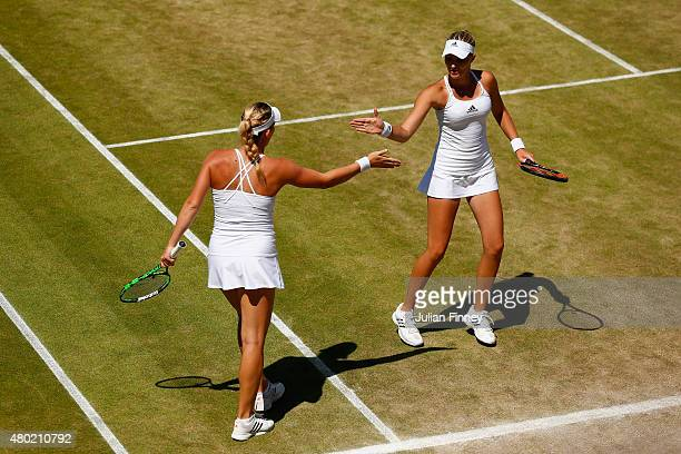 Ekaterina Makarova of Russia and Elena Vesnina of Russia celebrate winning the Ladies' Doubles Semi Final match against Timea Babos of Hungary and...
