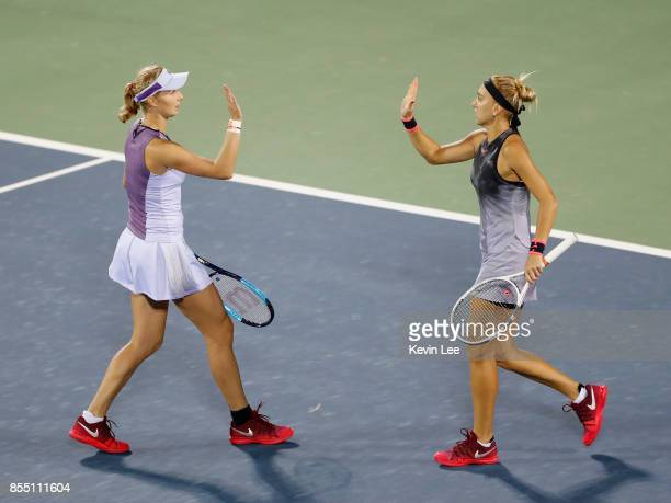 Ekaterina Makarova of Russia and Elena Vesnina of Russia gesture in a match against Shuko Aoyama of Japan and Zhaoxuan Yang of China during Quarter...