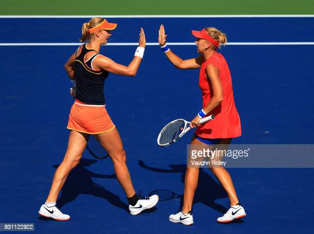 Ekaterina Makarova of Russia celebrates a point with partner Elena Vesnina of Russia as they compete against AnnaLena Groenefeld of Germany and Kveta...