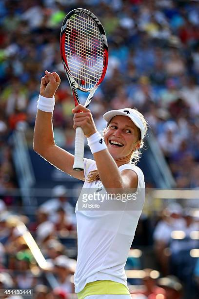 Ekaterina Makarova of Russia celebrates after defeating Eugenie Bouchard of Canada in their womens singles fourth round match on Day Eight of the...