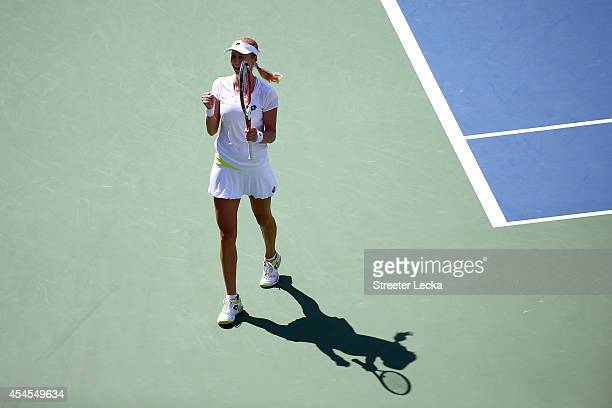 Ekaterina Makarova of Russia celebrates after defeating Victoria Azarenka of Belarus in their women's singles quarterfinal match on Day Ten of the...