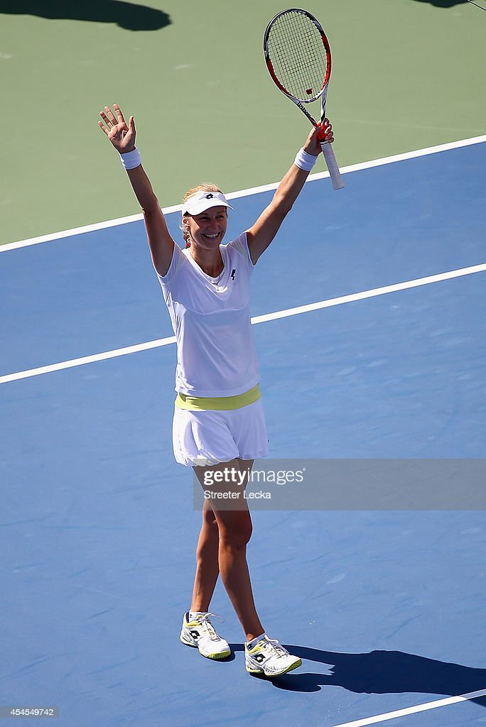 Ekaterina Makarova of Russia celebrates after defeating Victoria Azarenka of Belarus in their women's singles quarterfinal match on Day Ten of the 2014 US Open at the USTA Billie Jean King National Tennis Center on September 3, 2014 in the Flushing neighborhood of the Queens borough of New York City. Makarova defeated Azarenka 6-4, 6-2.