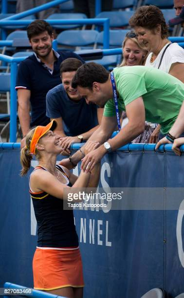 Ekaterina Makarova of Russia celebrates her win over Julia Goerges of Germany with family and friends at William HG FitzGerald Tennis Center on...