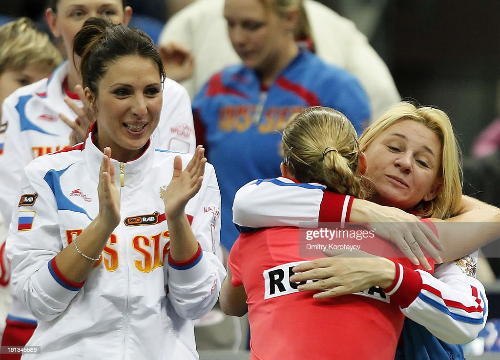 Ekaterina Makarova of Russia celebrates with teammates after winning against Kimiko Date-Krumm of Japan during day two of the Federation Cup 2013 World Group Quarterfinal match between Russia and Japan at Olympic Stadium on February 10, 2013 in Moscow, Russia.