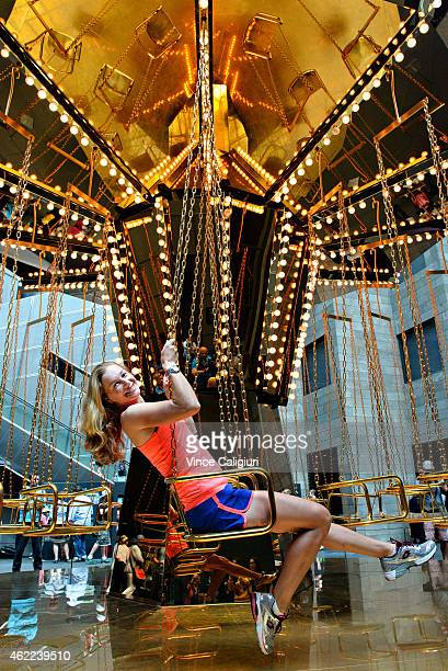Ekaterina Makarova of Russia enjoys a ride on the Golden Mirror Carousel at the National Gallery of Victoria during the 2015 Australian Open at...