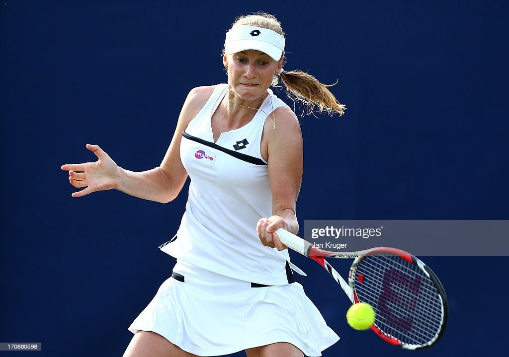 <a gi-track='captionPersonalityLinkClicked' href=/galleries/search?phrase=Ekaterina+Makarova&family=editorial&specificpeople=2364239 ng-click='$event.stopPropagation()'>Ekaterina Makarova</a> of Russia in action against Angelique Kerber of Germany during day five of the AEGON International tennis tournament at Devonshire Park on June 19, 2013 in Eastbourne, England.