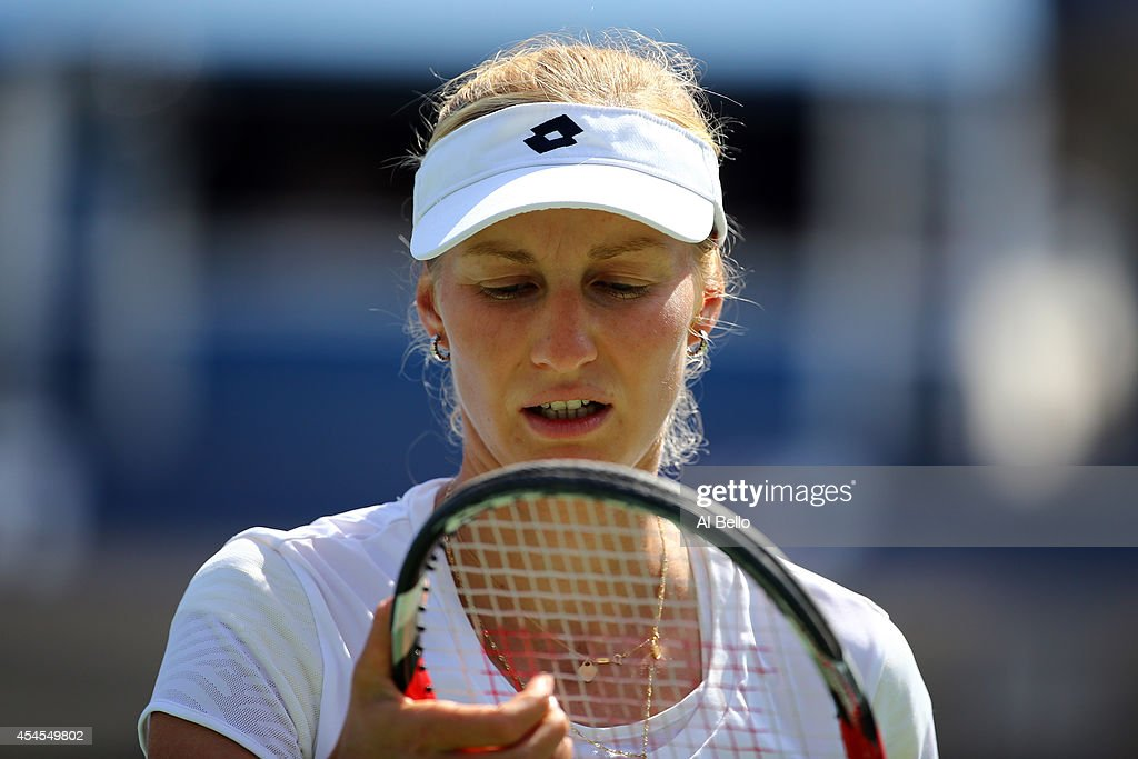 Ekaterina Makarova of Russia looks on against Victoria Azarenka of Belarus during threir women's singles quarterfinal match on Day Ten of the 2014 US Open at the USTA Billie Jean King National Tennis Center on September 3, 2014 in the Flushing neighborhood of the Queens borough of New York City.
