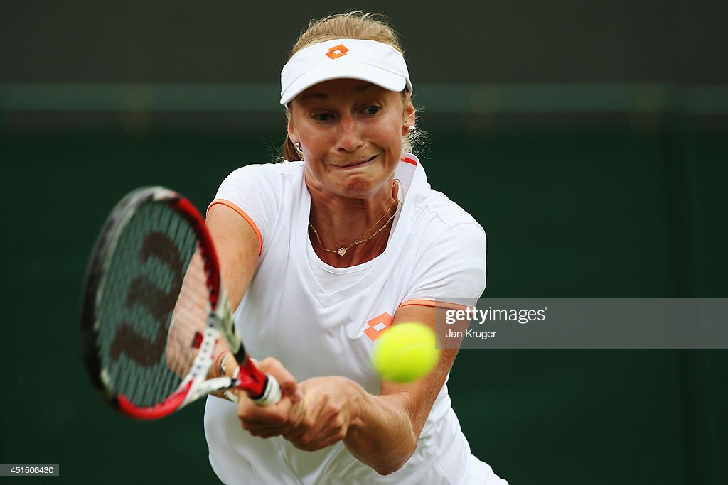 <a gi-track='captionPersonalityLinkClicked' href=/galleries/search?phrase=Ekaterina+Makarova&family=editorial&specificpeople=2364239 ng-click='$event.stopPropagation()'>Ekaterina Makarova</a> of Russia plays a backhand return during her Ladies' Singles fourth round match against Agnieszka Radwanska of Poland on day seven of the Wimbledon Lawn Tennis Championships at the All England Lawn Tennis and Croquet Club on June 30, 2014 in London, England.