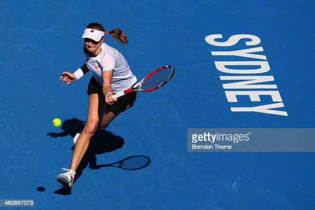 Ekaterina Makarova of Russia plays a forehand in her first round match against Jelena Jankovic of Serbia during day two of the Sydney International...