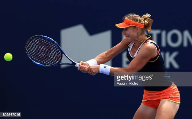 Ekaterina Makarova of Russia plays a shot against Lucie Safarova of the Czech Republic during Day 6 of the Rogers Cup at Aviva Centre on August 10...