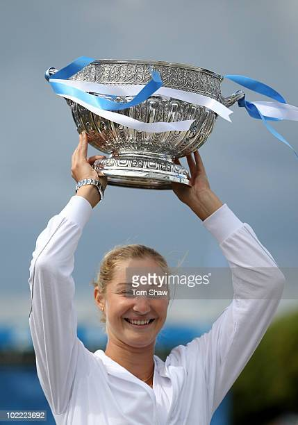 Ekaterina Makarova of Russia poses with the trophy after winning the womens final against Victoria Azarenka of Belarus during day six of the AEGON...