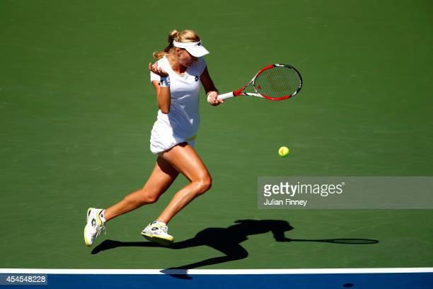 Ekaterina Makarova of Russia returns a shot against Victoria Azarenka of Belarus during threir women's singles quarterfinal match on Day Ten of the...