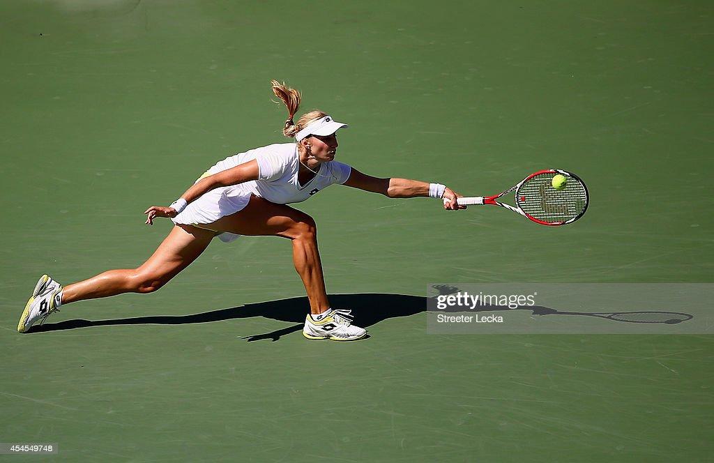 Ekaterina Makarova of Russia returns a shot against Victoria Azarenka of Belarus during threir women's singles quarterfinal match on Day Ten of the 2014 US Open at the USTA Billie Jean King National Tennis Center on September 3, 2014 in the Flushing neighborhood of the Queens borough of New York City.