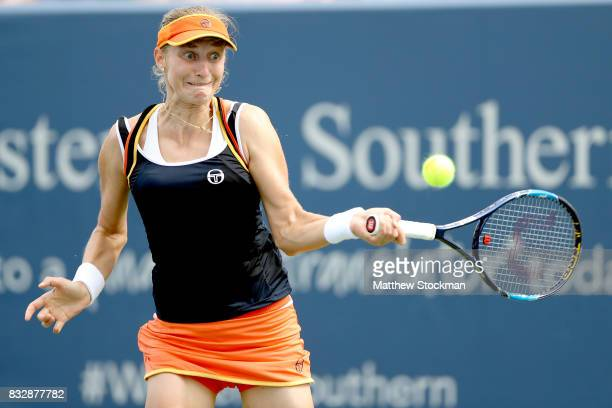 Ekaterina Makarova of Russia returns a shot to Angelique Kerber of Germany during day 5 of the Western Southern Open at the Lindner Family Tennis...
