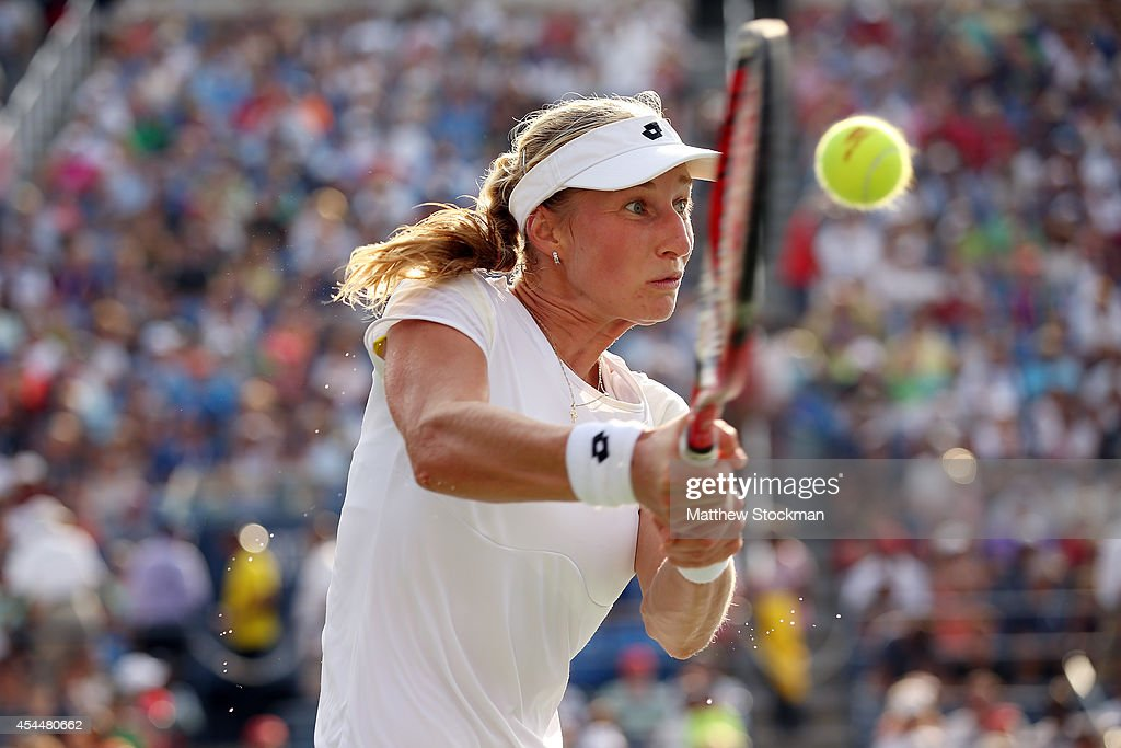 <a gi-track='captionPersonalityLinkClicked' href=/galleries/search?phrase=Ekaterina+Makarova&family=editorial&specificpeople=2364239 ng-click='$event.stopPropagation()'>Ekaterina Makarova</a> of Russia returns a shot to Eugenie Bouchard of Canada during their womens singles fourth round match on Day Eight of the 2014 US Open at the USTA Billie Jean King National Tennis Center on September 1, 2014 in the Flushing neighborhood of the Queens borough of New York City.