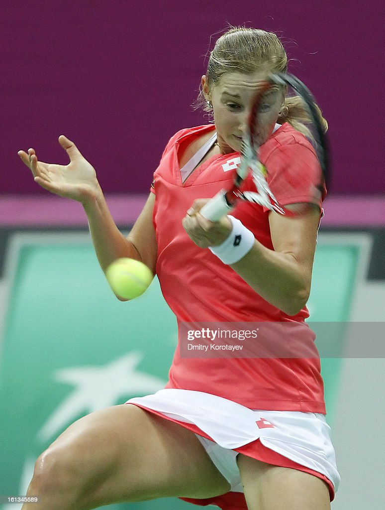 Ekaterina Makarova of Russia returns the ball against Kimiko Date-Krumm of Japan during day two of the Federation Cup 2013 World Group Quarterfinal match between Russia and Japan at Olympic Stadium on February 10, 2013 in Moscow, Russia.