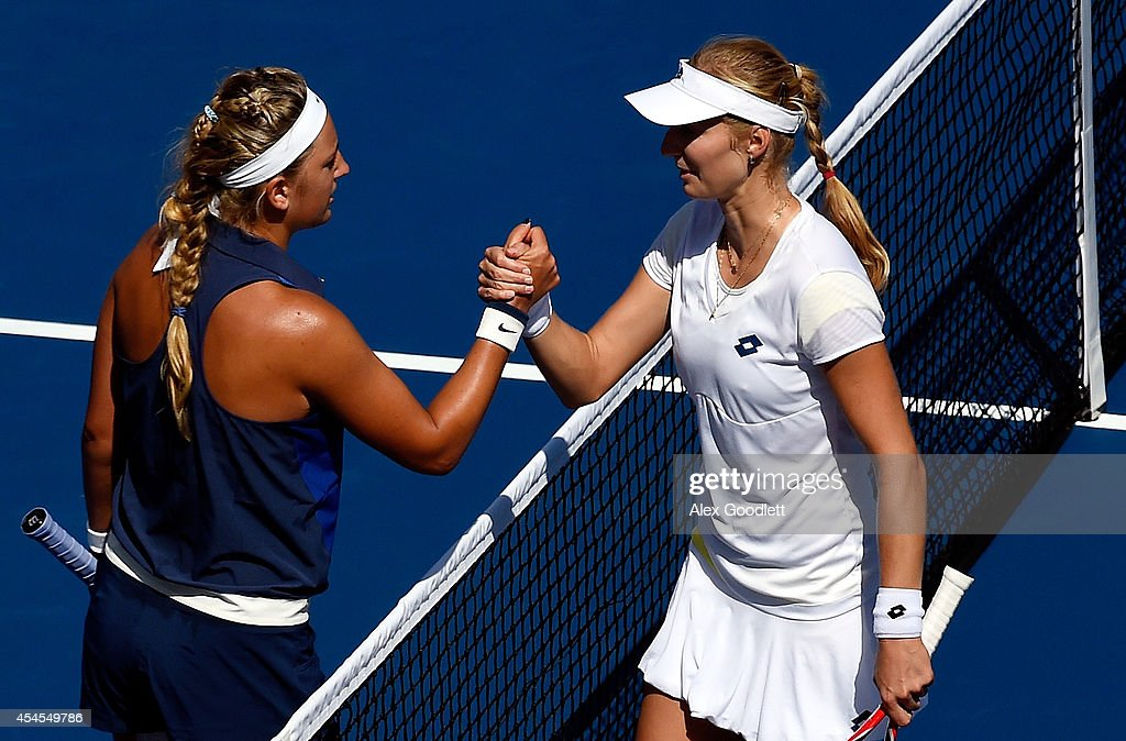 Ekaterina Makarova (R) of Russia shakes hands Victoria Azarenka (L) of Belarus after their women's singles quarterfinal match on Day Ten of the 2014 US Open at the USTA Billie Jean King National Tennis Center on September 3, 2014 in the Flushing neighborhood of the Queens borough of New York City. Makarova defeated Azarenka 6-4, 6-2.