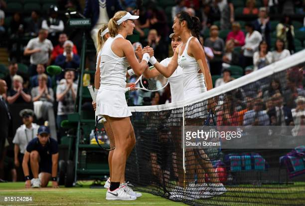 Ekaterina Makarova partnering Elena Vesnina of Russia shakes hands with HaoChing Chan of Chinese Taipei with Monica Niculescu of Romania after...