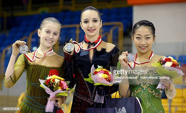 Ekaterina Mitrofanova of Russia presents the silver medal Polina Tsurskaya of Russia presents the gold medal and Rin Nitaya of Japan presents the...