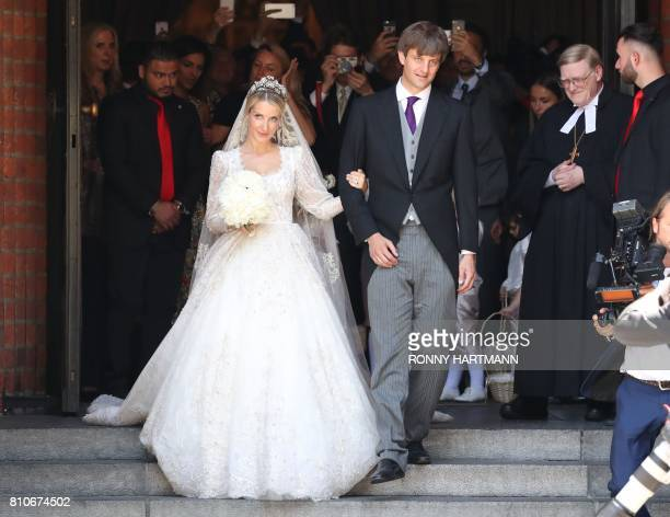 TOPSHOT Ekaterina of Hanover and Prince Ernst August of Hanover leave after their church wedding in Hanover central Germany on July 8 2017 Prince...