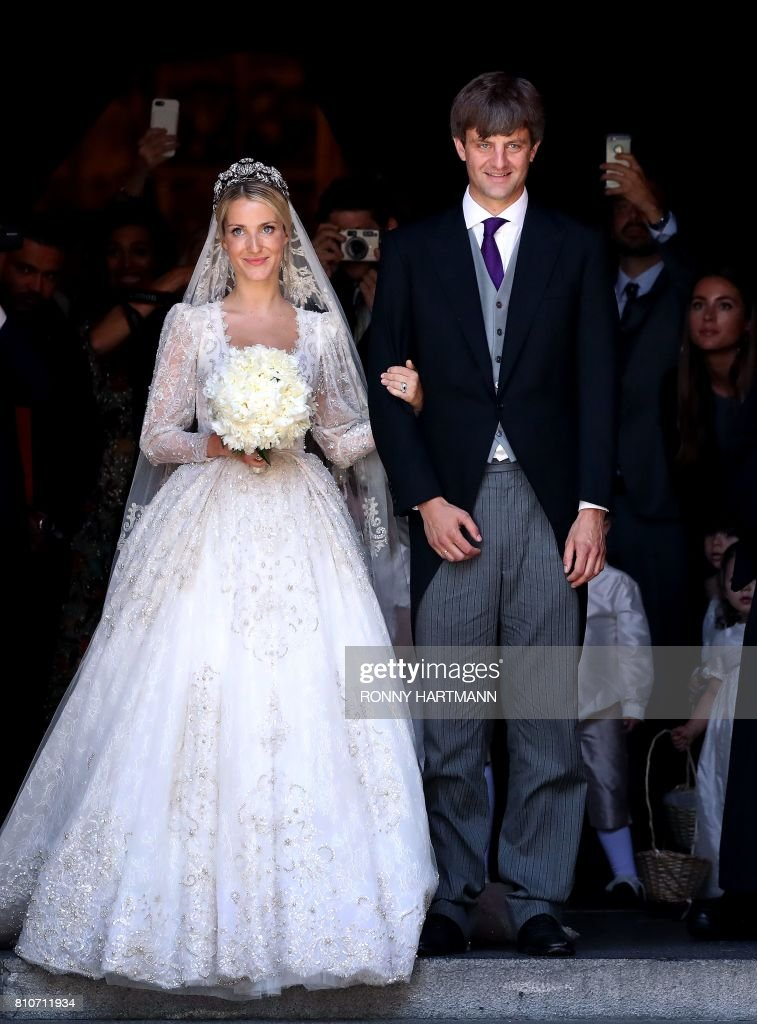 Ekaterina of Hanover (L) and Prince Ernst August (R) of Hanover leave after their church wedding ceremony in Hanover, central Germany, on July 8, 2017. Prince Ernst August of Hanover did not give i...