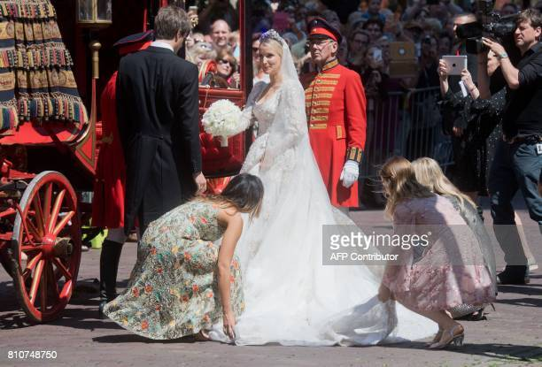 Ekaterina of Hanover is helped in a carriage next to her husband Prince Ernst August after their church wedding ceremony in Hanover central Germany...