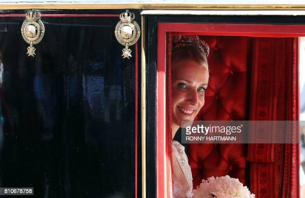 Ekaterina of Hanover sits in a carriage after their church wedding ceremony in Hanover central Germany on July 8 2017 Prince Ernst August of Hanover...