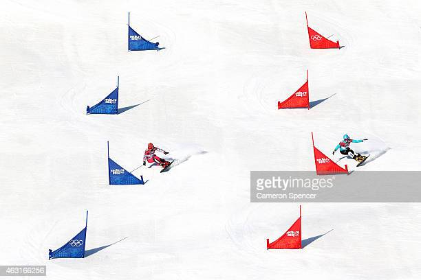 Ekaterina Tudegesheva of Russia and Anke Karstens of Germany compete in the Snowboard Ladies' Parallel Slalom Qualification on day 15 of the 2014...