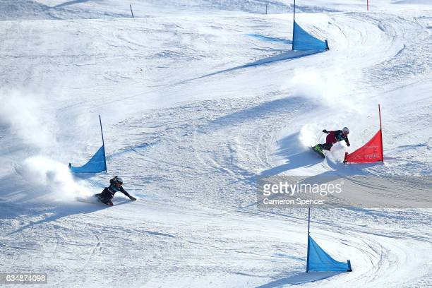 Ekaterina Tudegesheva of Russia competes against Ramona Theresia Hofmeister of Geramany in the FIS Freestyle World Cup Parallel Giant Slalom Ladies...