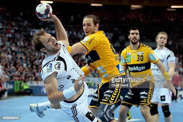 Ekdahl Du Rietz of Rhein Neckar challenges for the ball with Steffen Weinhold of Kiel during the DKB HBL Bundesliga match between THW Kiel and Rhein...