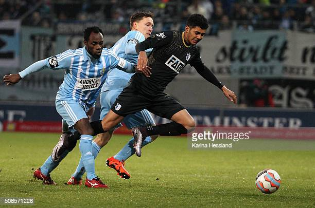 Eke Uzoma and Alexander Bittroff of Chemnitz challenge Tarek Chahed of Magdeburg during the Third League match between Chemnitzer FC and 1FC...