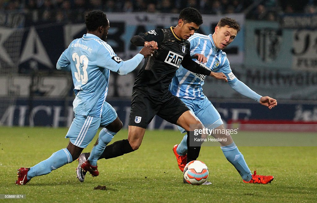 Eke Uzoma and Alexander Bittroff of Chemnitz challenge Tarek Chahed of Magdeburg during the Third League match between Chemnitzer FC and 1.FC Magdeburg at Stadion an der Gellertstrasse on February 05, 2016 in Chemnitz, Germany.