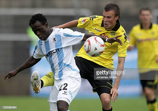 Eke Uzoma of Muenchen and Kevin Grosskreutz of Dortmund fight for the ball during the pre season friendly match 1860 Muenchen v Borussia Dortmund at...