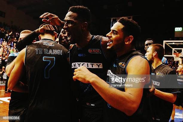 Ekene Ibekwe of the Breakers celebrates with Corey Webster of the Breakers after making the winning hsot to win game two of the NBL Grand Final...