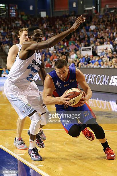 Ekene Ibekwe of the Breakers tries to block Adam Gibson of the 36ers during the round four NBL match between the Adelaide 36ers and the New Zealand...
