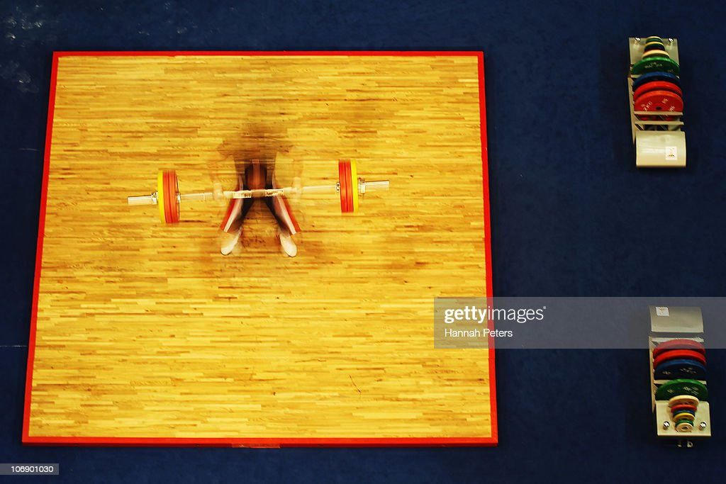 Ekkachai Yeeram of Thailand competes in the Men's Weightlifting 77kg competition during day four of the 16th Asian Games Guangzhou 2010 at Dongguan Gymnasium on November 16, 2010 in Guangzhou, China.