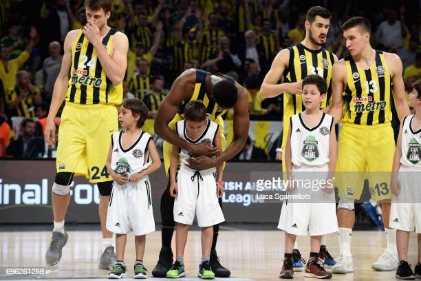 Ekpe Udoh #8 of Fenerbahce Istanbul embrace a kid before the Championship Game 2017 Turkish Airlines EuroLeague Final Four between Fenerbahce...