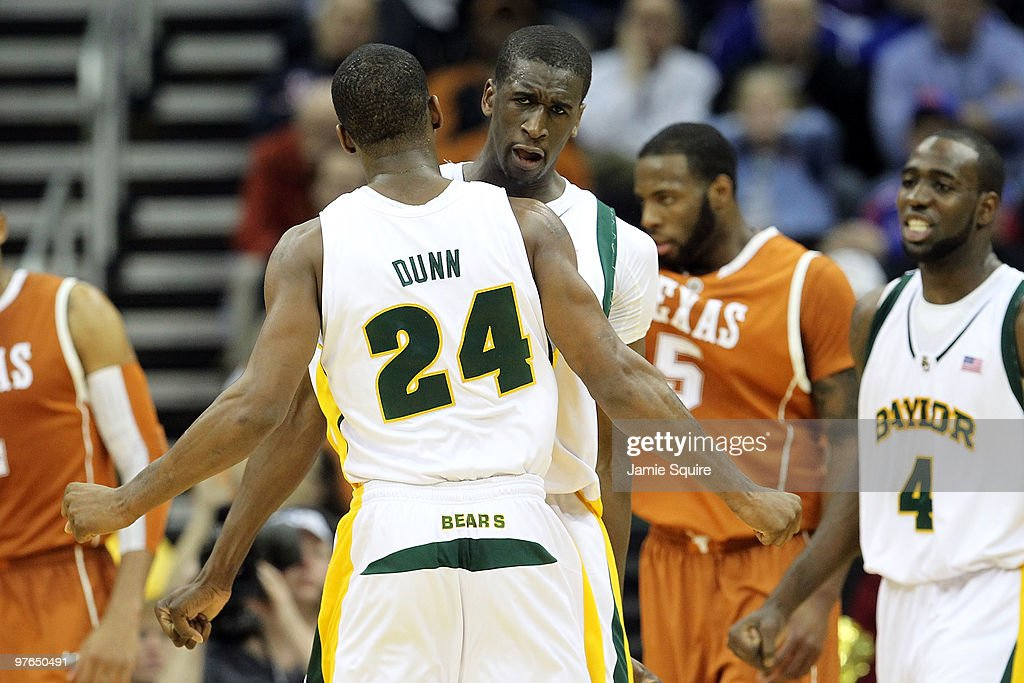 Ekpe Udoh #13 and LaceDarius Dunn #24 of the Baylor Bears react late in the second half while taking on the Texas Longhorns during the quarterfinals of the 2010 Phillips 66 Big 12 Men's Basketball Tournament at the Sprint Center on March 11, 2010 in Kansas City, Missouri.