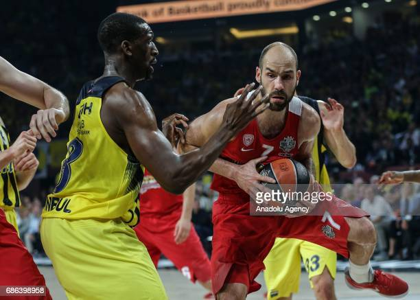 Ekpe Udoh of Fenerbahce in action against Vassilis Spanoulis of Olympiacos during the Turkish Airlines Euroleague Final Four basketball final match...