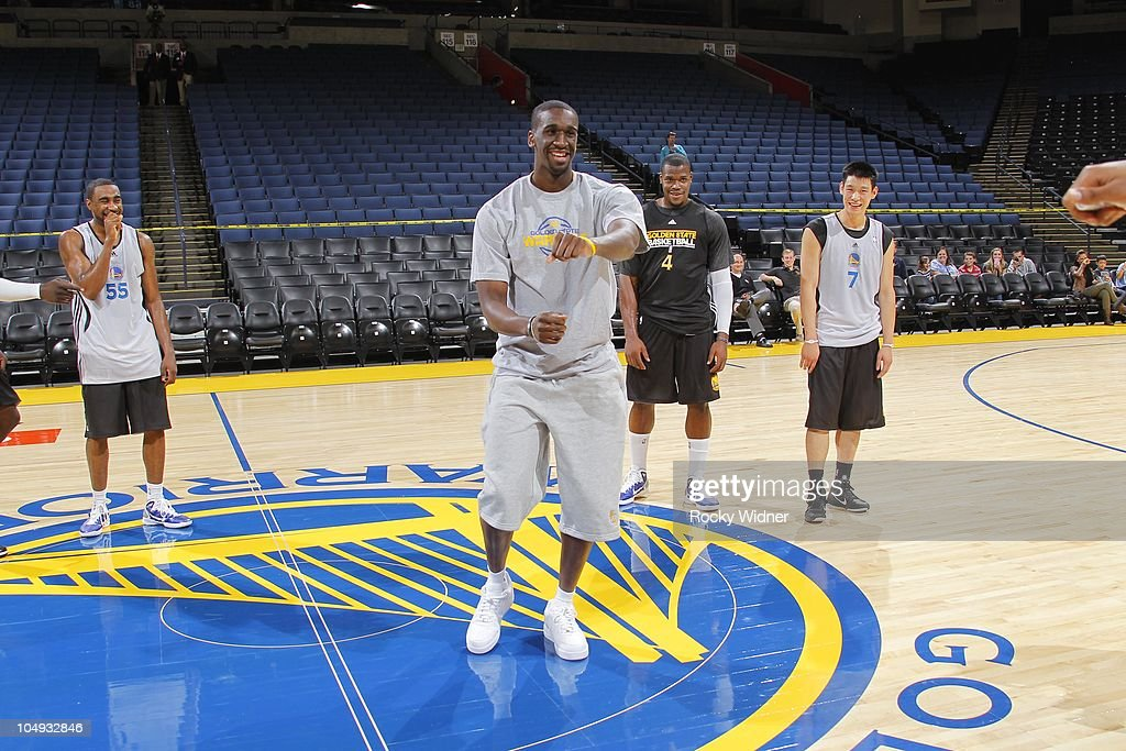 Ekpe Udoh #20 of the Golden State Warriors dances with the other rookies at the team's annual Open Practice on October 6, 2010 in Oakland, California.