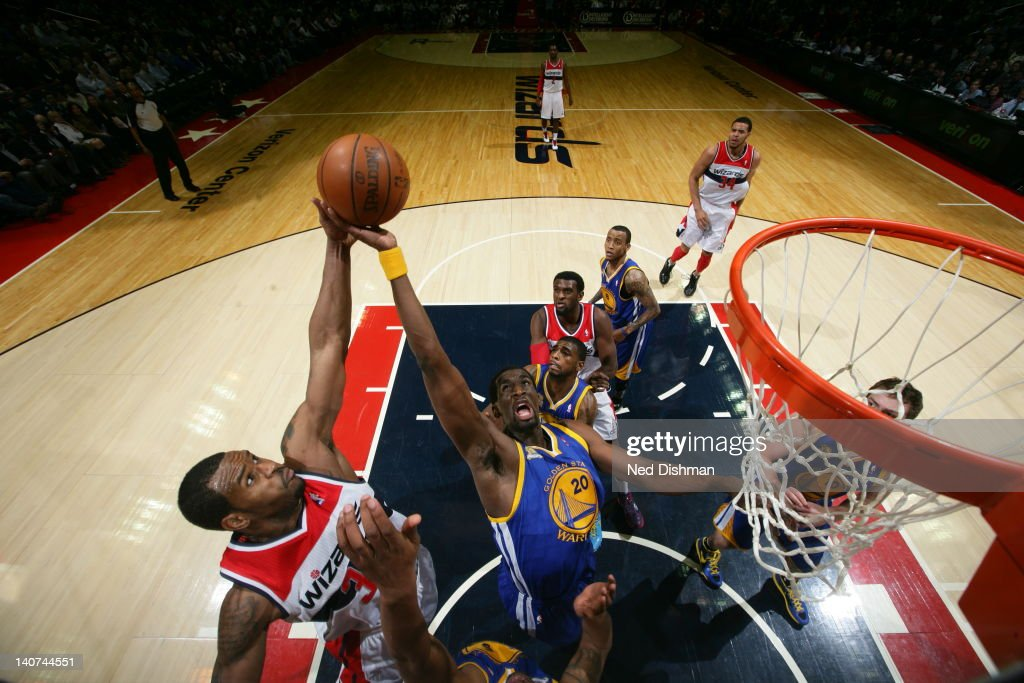 <a gi-track='captionPersonalityLinkClicked' href=/galleries/search?phrase=Ekpe+Udoh&family=editorial&specificpeople=4185351 ng-click='$event.stopPropagation()'>Ekpe Udoh</a> #20 of the Golden State Warriors gains the ball during the game between the Washington Wizards and the Golden State Warriors at the Verizon Center on March 5, 2012 in Washington, DC.