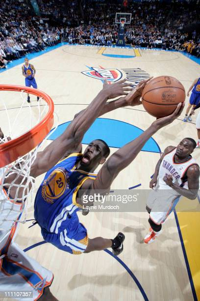Ekpe Udoh of the Golden State Warriors shoots against the Oklahoma City Thunder on March 29 2011 at the Oklahoma City Arena in Oklahoma City Oklahoma...