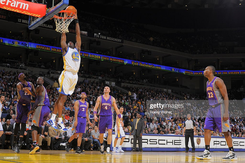 <a gi-track='captionPersonalityLinkClicked' href=/galleries/search?phrase=Ekpe+Udoh&family=editorial&specificpeople=4185351 ng-click='$event.stopPropagation()'>Ekpe Udoh</a> #20 of the Golden State Warriors throws down a dunk against the Phoenix Suns on February 7, 2011 at Oracle Arena in Oakland, California.