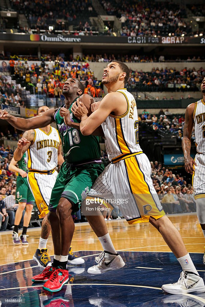<a gi-track='captionPersonalityLinkClicked' href=/galleries/search?phrase=Ekpe+Udoh&family=editorial&specificpeople=4185351 ng-click='$event.stopPropagation()'>Ekpe Udoh</a> #13 of the Milwaukee Bucks battles for rebound position against Jeff Pendergraph #29 of the Indiana Pacers on March 22, 2013 at Bankers Life Fieldhouse in Indianapolis, Indiana.