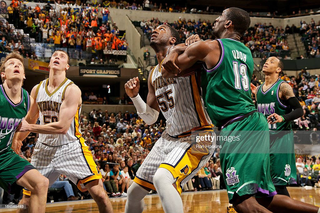 <a gi-track='captionPersonalityLinkClicked' href=/galleries/search?phrase=Ekpe+Udoh&family=editorial&specificpeople=4185351 ng-click='$event.stopPropagation()'>Ekpe Udoh</a> #13 of the Milwaukee Bucks battles for rebound position against <a gi-track='captionPersonalityLinkClicked' href=/galleries/search?phrase=Roy+Hibbert&family=editorial&specificpeople=725128 ng-click='$event.stopPropagation()'>Roy Hibbert</a> #55 of the Indiana Pacers on March 22, 2013 at Bankers Life Fieldhouse in Indianapolis, Indiana.