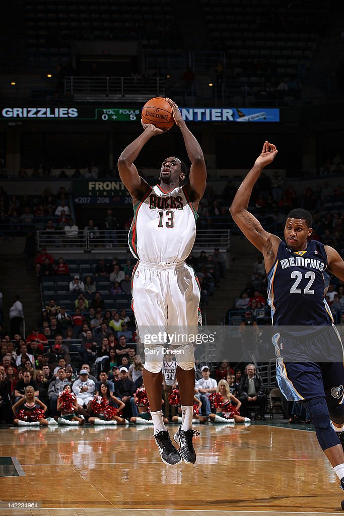 Ekpe Udoh #13 of the Milwaukee Bucks draws a foul on a 3-point attempt against Rudy Gay #22 of the Memphis Grizzlies on March 31, 2012 at the Bradley Center in Milwaukee, Wisconsin.