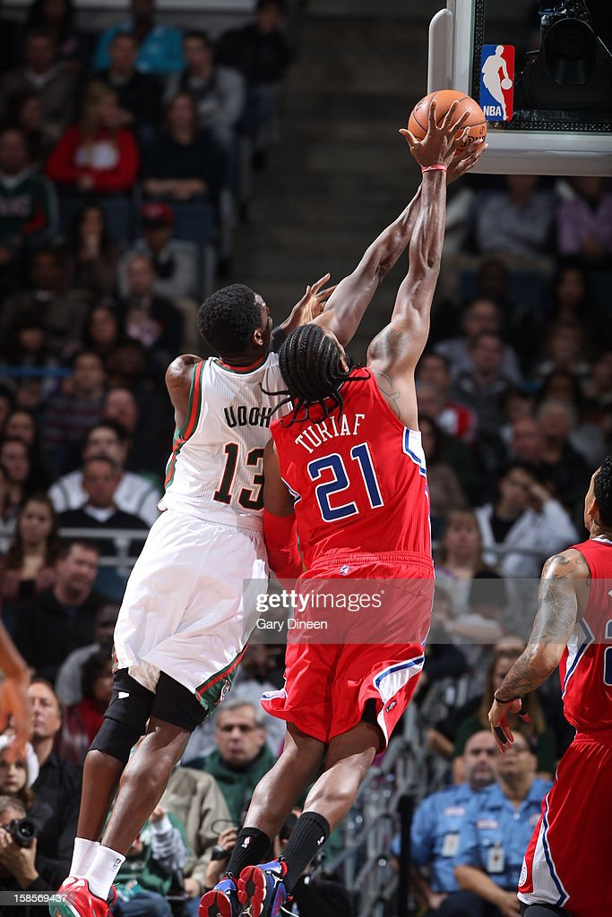 <a gi-track='captionPersonalityLinkClicked' href=/galleries/search?phrase=Ekpe+Udoh&family=editorial&specificpeople=4185351 ng-click='$event.stopPropagation()'>Ekpe Udoh</a> #13 of the Milwaukee Bucks drives to the basket while guarded by <a gi-track='captionPersonalityLinkClicked' href=/galleries/search?phrase=Ronny+Turiaf&family=editorial&specificpeople=224998 ng-click='$event.stopPropagation()'>Ronny Turiaf</a> #21 of the Los Angeles Clippers on December 15, 2012 at the BMO Harris Bradley Center in Milwaukee, Wisconsin.