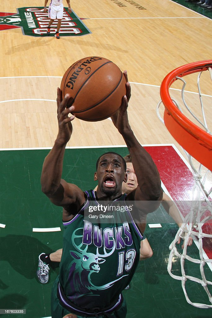 Ekpe Udoh #13 of the Milwaukee Bucks grabs a rebound against the Oklahoma City Thunder on March 30, 2013 at the BMO Harris Bradley Center in Milwaukee, Wisconsin.