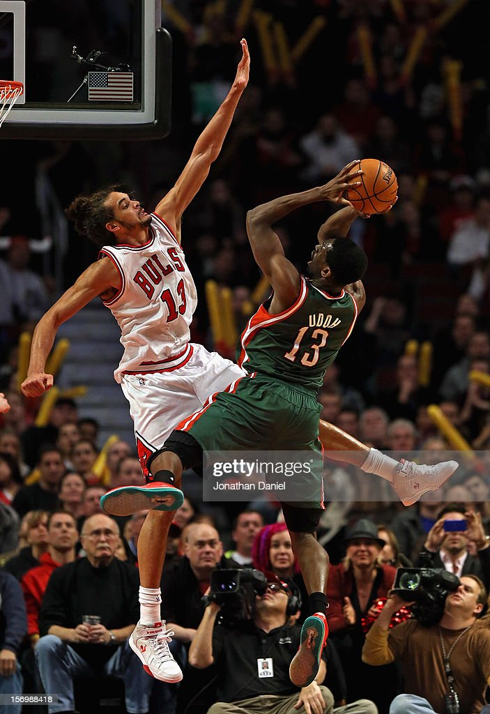 <a gi-track='captionPersonalityLinkClicked' href=/galleries/search?phrase=Ekpe+Udoh&family=editorial&specificpeople=4185351 ng-click='$event.stopPropagation()'>Ekpe Udoh</a> #13 of the Milwaukee Bucks puts up a shot against <a gi-track='captionPersonalityLinkClicked' href=/galleries/search?phrase=Joakim+Noah&family=editorial&specificpeople=699038 ng-click='$event.stopPropagation()'>Joakim Noah</a> #13 of the Chicago Bulls at the United Center on November 26, 2012 in Chicago, Illinois. The Bucks defeated the Bulls 93-92.