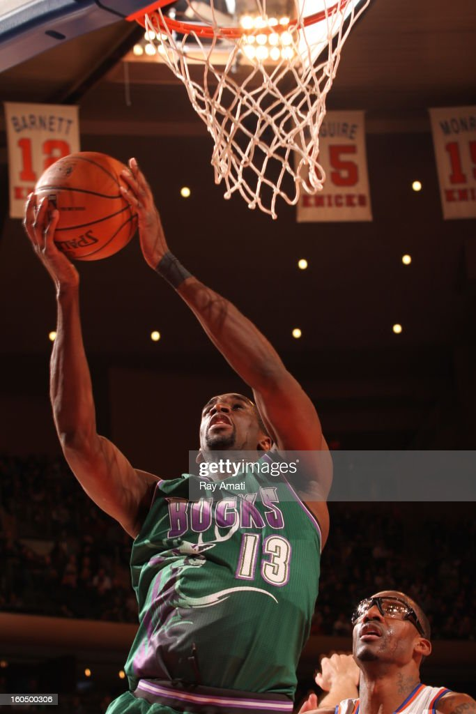 <a gi-track='captionPersonalityLinkClicked' href=/galleries/search?phrase=Ekpe+Udoh&family=editorial&specificpeople=4185351 ng-click='$event.stopPropagation()'>Ekpe Udoh</a> #13 of the Milwaukee Bucks shoots a layup the New York Knicks on February 1, 2013 at Madison Square Garden in New York City .